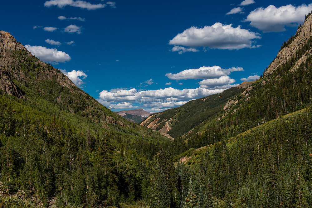 A lush valley, unusual for early fall, in the San Juan mountains of southwestern Colorado.