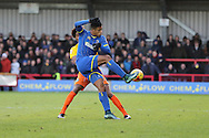 Lyle Taylor of AFC Wimbledon gets the better of Sido Jombati of Wycombe Wanderers during the Sky Bet League 2 match between AFC Wimbledon and Wycombe Wanderers at the Cherry Red Records Stadium, Kingston, England on 21 November 2015. Photo by Stuart Butcher.