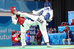BUENOS AIRES, Oct. 12, 2018  Fatima-Ezzahra Aboufaras (R) of Morocco competes with Kimia Hemati of Iran during the women's +63kg taekwondo final at the 2018 Summer Youth Olympic Games in Buenos Aires, Argentina on Oct. 11, 2018. Fatima-Ezzahra Aboufaras won 18-16. (Credit Image: © Li Ming/Xinhua via ZUMA Wire)