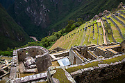 A view of the sun temple from above at the ancient site of Machu Pichu in the Cusco region of Peru. The sun temple was dedicated to the solar god and patron Incan deity, Inti. The temple was an important observatory in which the measurement of the solstices was undertaken. Underneath the Sun Temple is a cave-like room named the Royal Tomb in which the nobles and possible the Sapa Inca, ruler of the Cusco Empire and later the Inca Empire, were laid to rest in their mummified state.