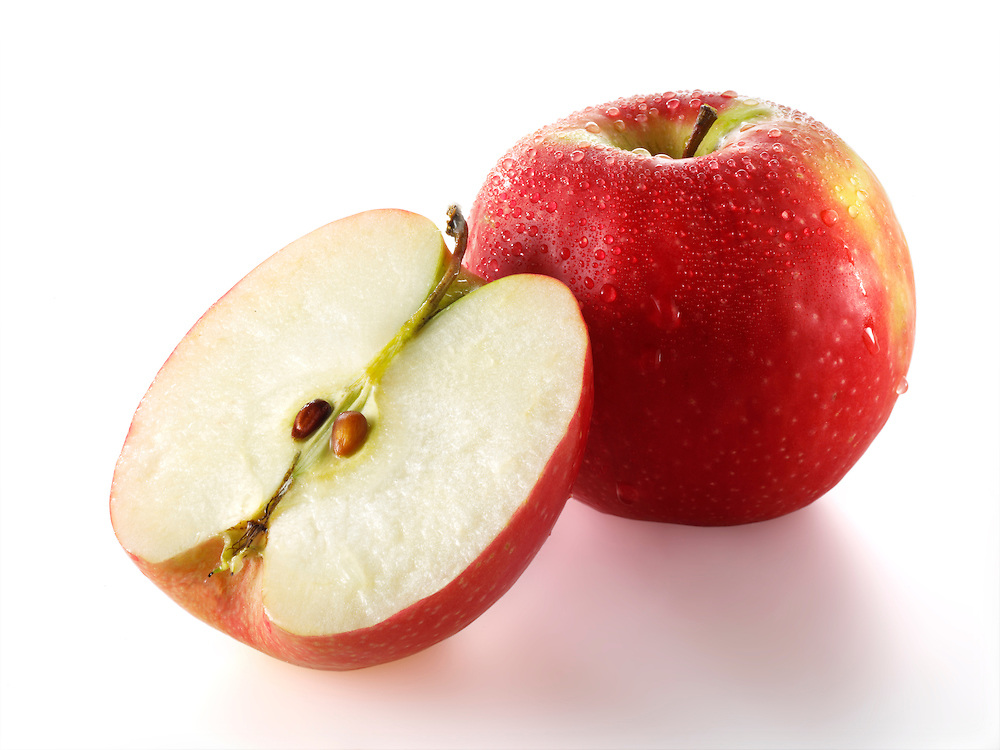 Fresh whole and sliced red Discovery apple