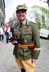 © Paul Thompson licensed to London News Pictures. 16/05/2015. Haworth, West Yorkshire, UK. A man dressed in German Army uniforms at Haworth 1940s weekend, an annual event in which people dress in period costume and visit the village of Haworth to relive the 1940s. After complaints in previous years, the organisers have requested that people don't wear German Uniforms. Photo credit : Paul Thompson/LNP