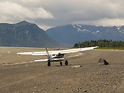 A bush plane takes off from the shore of Chinitna Bay, Lake Clark National Park, Alaska.