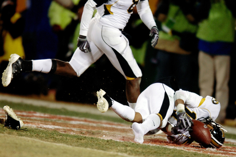Missouri defensive back Tru Vaughns loses and shoe and fumbles an interception in the OU endzone in the fourth quarter.