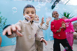 Group of little boys playing with bubbles,
