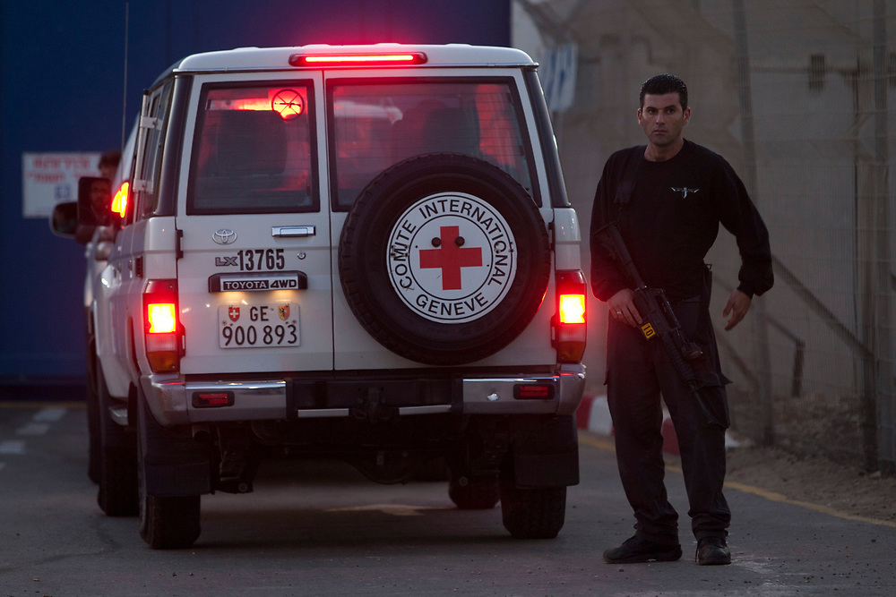 Red Cross vehicles arrive at Israel's Ofer prison, between Jerusalem and Ramallah, on October 18, 2011, for the transfer of Palestinian prisoners from Israel to Ramallah and east Jerusalem. A high-profile prisoner swap which will see the release of captive Israel Defense Forces soldier Gilad Shalit began before dawn on Tuesday. Shalit is to be freed after more than 5 years of captivity in Gaza in an exchange deal which will see the release of 477 Palestinian prisoners in an initial deal with another 550 to freed after the return of Shalit.