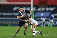 Kieran Fonotia of the Ospreys (l) makes a break. European Rugby Champions Cup, pool 2 match, Ospreys v ASM Clermont Auvergne at the Liberty Stadium in Swansea, South Wales on Sunday 15th October 2017.<br /> pic by  Andrew Orchard, Andrew Orchard sports photography.