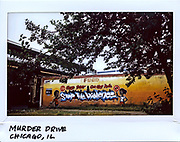 """A mural painted on the side of store in the 400 block of East 63rd Street in Chicago, an area also known as """"Murder Drive"""" in this photo taken October 11, 2017. The area is also known as """"O Block"""" near where former first lady Michelle Obama grew up."""