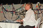 Israel, Jordan Valley, Kibbutz Ashdot Yaacov, Saraleh Sharon hosting a sing-along