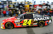 Jeff Gordon heads to the track for a run during practice for Sunday's NASCAR Sprint Cup race at Kansas Speedway in Kansas City, Kan., Saturday, Oct. 5, 2013. (AP Photo/Colin E. Braley)