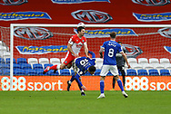 Cardiff City's Kieffer Moore (10) is fouled by Millwall's Ryan Leonard (18) during the EFL Sky Bet Championship match between Cardiff City and Millwall at the Cardiff City Stadium, Cardiff, Wales on 30 January 2021.