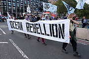 Ocean Rebellion activists hold their banner at the Marine Rebellion march on 6th September 2020 in London, United Kingdom. Ocean Rebellion, Sea Life Extinction, Animal Rebellion and Extinction Rebellion joined together to celebrate the biodiversity found in our seas, and to grieve at the destruction of the Earth's oceans and marine life due to climate breakdown and human interference, and the loss of lives, homes and livelihoods from rising sea levels. Extinction Rebellion is a climate change group started in 2018 and has gained a huge following of people committed to peaceful protests. These protests are highlighting that the government is not doing enough to avoid catastrophic climate change and to demand the government take radical action to save the planet.