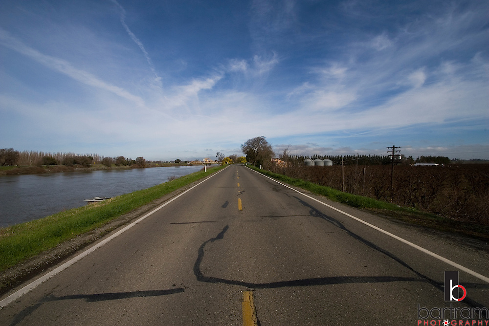 River Road runs atop a levee along the Sacramento River just north of Walnut Grove, California on Monday, February 25, 2008. The levees separate the river from the fertile farm land of the Sacramento and San Joaquin Delta. (Photo by Kevin Bartram)