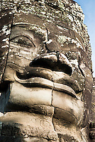 One of many smiling stone faces at The Bayon temple in the walled city of Angkor Thom, Siem Reap, Cambodia