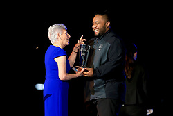 President of the Commonwealth Games Federation Louise Martin presents heavyweight lifter David Liti with the athlete of the games award during the Closing Ceremony for the 2018 Commonwealth Games at the Carrara Stadium in the Gold Coast, Australia.