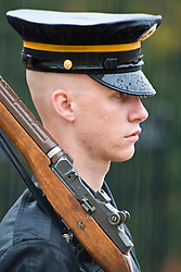 U.S. Soliders keeps watch on the Tomb of the Uknown Soilders at Arlington National Cemetery during the rain.