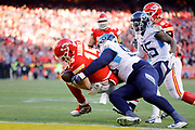 Kansas City Chiefs quarterback Patrick Mahomes (15) scrambles for a touchdown as Tennessee Titans linebacker Derick Roberson (50) and defensive back Tramaine Brock (35) defends during an NFL, AFC Championship football game Sunday, Jan. 19, 2020, in Kansas City, MO. The Chiefs won 35-24 to advance to Super Bowl 54. (AP Photo/Colin E. Braley) Colin Eric Braley Photography