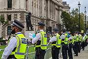Police officers form a line outside the Houses of Parliament, Westminster Palace during an Extinction Rebellion protest in central London on Wednesday, Sept 3, 2020. The environmental nonviolent campaign group Extinction Rebellion plans to hold 10 days of demonstrations across central London as part of its ongoing campaign to highlight climate change. Peaceful actions swarmed central London into a standoff, demanding that the central government obeys and delivers Climate and Ecological Emergency Bill and prepare for crisis with a National Citizens' Assembly. (VXP Photo/ Vudi Xhymshiti)