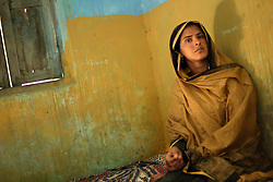 Mukhtar Mai, 33, is seen inside her home in Meerwala, Pakistan, April 29, 2005. Mai, went against the Pakistani tradition of committing suicide when she brought charges against the men who gang raped her nearly three years ago. With money from the ruling she opened two schools, one for girls, the other for boys, citing that education is the only thing that will stop such acts from happening.