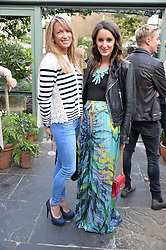 Left to right, EMILY CROMPTON-CANDY and ROSANNA FALCONER at a party to celebrate 'A Year In The Garden' celebrating the first year of The Ivy Chelsea Garden, 197 King's Road, London on 16th May 2016.