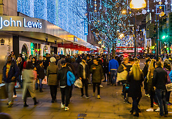 London, December 23 2017. Shoppers crowd London's Oxford Street on the second last shopping days before Christmas, with many shops now offering up to 70% off as they push to make their sales projections. © Paul Davey