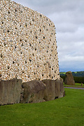 This quartz and granite face is a modern reconstruction - using the original materials - of how Newgrange must have looked 5,000 years ago. The quartz came from about 60km south, while the granite rocks came from farther north. The stones on the bottom weigh between 1 and 10 tonnes - and were put here 5,000 years ago!..