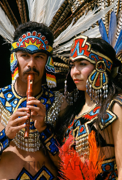 Musicians in Mexican Aztec Indian traditional costumes in Los Angeles, California, USA