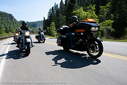 Will and Lance head up the Knight family riding together on the Cycle Source annual ride to the hills during the Sturgis Motorcycle Rally. SD, USA. Wednesday, August 11, 2021. Photography ©2021 Michael Lichter.