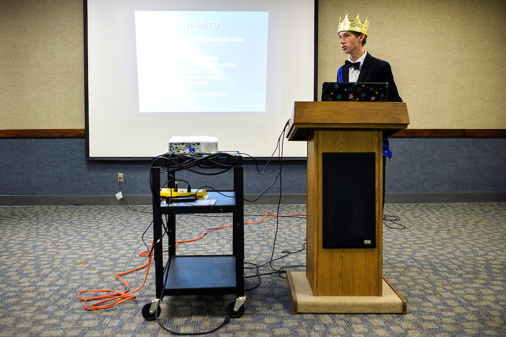 """Anaheim , California - April 11, 2015: Grand Duke Jacob Felts, 16, from Broslavia, gives a presentation titled """"Challenges to Intermicronational Trade."""" His solution? Form the National American InterMicronational Trade Organization, or """"NAIMTO."""" Micronations are expensive to run points out Grand Duke Jacob, and proposes that micronations in aligned with NAIMTO sell """"boring stuff"""" -- reusable items that people will need to repurchase. The Republic of Molossia sells Supremo Soap, and Broslovia is attempting to make recycled paper.  <br /> <br /> <br /> Broslovia is a micronation located in Albuquerque, New Mexico. It's claimed province not only over Grand Duke Jacob's house, Feltasia, the capital of Broslovia, and his friend Lord Henry's house, titled New Southland, but also Pluto, the dwarf planet. <br /> <br /> When asked if Broslavia holds elections he said his nation is an Absolute Monarchy, """"I'm a libertarian, so I do enough to be a bad leader.""""<br /> <br /> MicroCon 2015 is a Micronation conference held at the Anaheim Central Library.<br /> CREDIT: Matt Roth"""