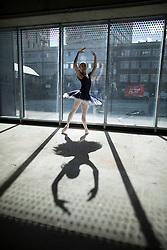 © Licensed to London News Pictures. 21/03/2017. London, UK. A performer poses in The Central School of Ballet's newly announced building in central London. The dancers wear costumes from their forthcoming nationwide Ballet Central tour 2017 against the backdrop of the unfinished interior of the new premises. Photo credit: Peter Macdiarmid/LNP