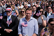 """Attendees listen as President Donald Trump speaks during a """"Celebration of America"""" event on the South Lawn of the White House on June 5, 2018 in Washington, DC. The celebration is being staged as a replacement for a White House visit by the Super Bowl champion Philadelphia Eagles. Some of the team was planning on boycotting the event due to the President's stance on players kneeling during the National Anthem at NFL games, so Trump resented their invitation.      Photo by Pete Marovich/UPI"""