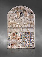 """Ancient Egyptian stele odedicated to Amon Re the """"good Ram"""" by foreman Baki, limestone, New Kingdom, 19th Dynasty, (1290-1213 BC), Deir el-Medina, Drovetti cat 1549. Egyptian Museum, Turin. Grey background. Reign of Ramesses II.<br /> <br /> This round-topped stele is carved in low relief and painted <br /> in several colours. The pictorial plane is divided into two <br /> registers, the upper one containing two rams facing each <br /> other. The animals, with cobras rising on their foreheads, <br /> wear tall headdresses composed of two tall plumes with a <br /> solar disk at the centre. Between them is a small offering <br /> table with lotus flowers. The mirror image hieroglyphic <br /> inscription refers to the rams and reveals their divine <br /> nature as that of Amun-Ra. In the register below, <br /> foreman Baki is shown in the pose of adoration. .<br /> <br /> If you prefer to buy from our ALAMY PHOTO LIBRARY  Collection visit : https://www.alamy.com/portfolio/paul-williams-funkystock/ancient-egyptian-art-artefacts.html  . Type -   Turin   - into the LOWER SEARCH WITHIN GALLERY box. Refine search by adding background colour, subject etc<br /> <br /> Visit our ANCIENT WORLD PHOTO COLLECTIONS for more photos to download or buy as wall art prints https://funkystock.photoshelter.com/gallery-collection/Ancient-World-Art-Antiquities-Historic-Sites-Pictures-Images-of/C00006u26yqSkDOM"""