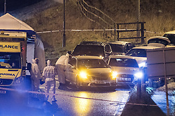 © Licensed to London News Pictures. 03/01/2017. Huddersfield, UK. Forensic officers at the scene of a bullet riddled white Audi car at the slip road at Junction 24 of the M62 motorway in Huddersfield . West Yorkshire police have announced a man has died following the discharge of a police firearm , during what they describe as a pre-planned operation , yesterday evening (2nd January 2017) . Photo credit : Joel Goodman/LNP