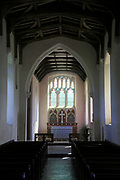 East window, nave and altar in All Saints church, Ellough, Suffolk, England, UK