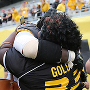 ORLANDO, FL - JANUARY 01:  MVP Markus Golden #33 of the Missouri Tigers hug his mother Rhonda after winning the Buffalo Wild Wings Citrus Bowl between the Minnesota Golden Gophers and the Missouri Tigers at the Florida Citrus Bowl on January 1, 2015 in Orlando, Florida. (Photo by Alex Menendez/Getty Images) *** Local Caption *** Markus Golden