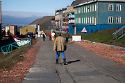 Miner walking along the street in Barentsburg, a Russian coal mining town in the Norwegian Archipelego of Svalbard. Once home to about 2000 miners and their families, less than 500 people now live here.