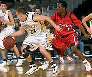 2/11/06 -- Omaha, Ne.San Diego Hoovers JayDee Luster  defends against Lincoln Southeast's  Kris Bauer at The Omaha Shootout, a High School Basketball tournament featuring some of the best prospects at the Qwest Center Omaha...(Photo by Chris Machian/Prarie Pixel Group).