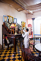 Altar with photographs of saints and dignitories at the Great Divine Temple of Cao Dai in Tay Ninh.