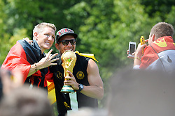 15.07.2014, Brandenburger Tor, Berlin, GER, FIFA WM, Empfang der Weltmeister in Deutschland, Finale, im Bild Bastian Schweinsteiger (GER) li. und Lukas Podolski (GER) re. mit dem FIFA-WM-Pokal. Rechts Kevin Grosskreutz (GER), // during Celebration of Team Germany for Champion of the FIFA Worldcup Brazil 2014 at the Brandenburger Tor in Berlin, Germany on 2014/07/15. EXPA Pictures © 2014, PhotoCredit: EXPA/ Eibner-Pressefoto/ Harzer<br /> <br /> *****ATTENTION - OUT of GER*****