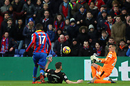 Karl Darlow, the goalkeeper of Newcastle United (R) saves a shot at goal from Christian Benteke of Crystal Palace (L). Premier League match, Crystal Palace v Newcastle Uutd at Selhurst Park in London on Sunday 4th February 2018. pic by Steffan Bowen, Andrew Orchard sports photography.