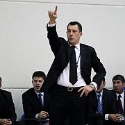 Anadolu Efes's coach Ufuk Sarica (C) during their Turkish Basketball league derby match  Fenerbahce Ulker between Anadolu Efes at Caferaga Sports Hall in Istanbul, Turkey, Saturday 01, 2012. Photo by TURKPIX