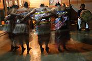 Amerindian Dancers dance for tourists in the remote village of Christiankondre Suriname.