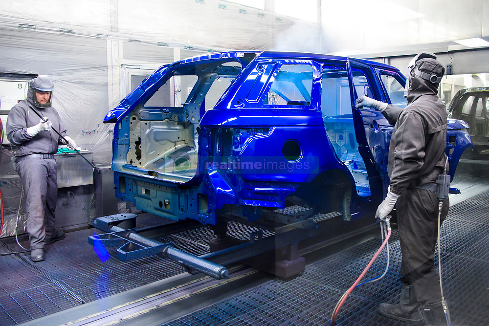 Cars are spray painted in the Paint Shop, part of Jaguar Land Rover's Advanced Manufacturing Facility in Solihull, Birmingham. Picture date: Wednesday March 15th, 2017. Photo credit should read: Matt Crossick/ EMPICS. The Paint shop uses 26km of conveyors, and a mixture of hand-painting and automated robots paint each car body over a period of 10 hours.