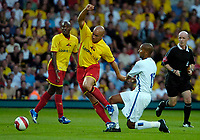 Photo: Ed Godden.<br /> Watford v Inter Milan. Pre Season Friendly. 08/08/2006.<br /> Olivier Dacourt (R) brings down Watford's Gavin Mahon.