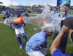 June 21, 2017 - Kansas City, MO, USA - Kansas City Royals' Salvador Perez ducks under the Gatorade splash from Drew Butera after the teams 6-4 win over the Boston Red Sox during Wednesday's baseball game at Kauffman Stadium in Kansas City, Mo. Perez hit his first grand slam in the 8th inning for the go ahead runs. (Credit Image: © John Sleezer/TNS via ZUMA Wire)