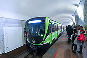 Passengers board a train from Republic Square station in Armenia's capital city Yerevan metro on Friday, Jan 29, 2021. Yerevan metro has one line and operates 10 stations. The frequency of the trains during the busy hours is every five minutes, and the other hours, 15 minutes. (Photo/ Vudi Xhymshiti)