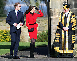 Prince William and Kate Middleton look toward Sir Menzies Campbell as they arrive in the Quadrangle during a visit to the University of St Andrews, where they first met.