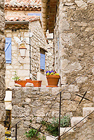 old stone walls and narrow walkway in the mountain village of Gourdon, France