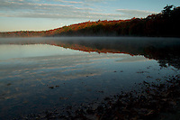 Morning mist rising from Walden Pond in the fall.