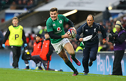 Ireland's Jacob Stockdale (centre) on his way to scoring his side's third try during the NatWest 6 Nations match at Twickenham Stadium, London.